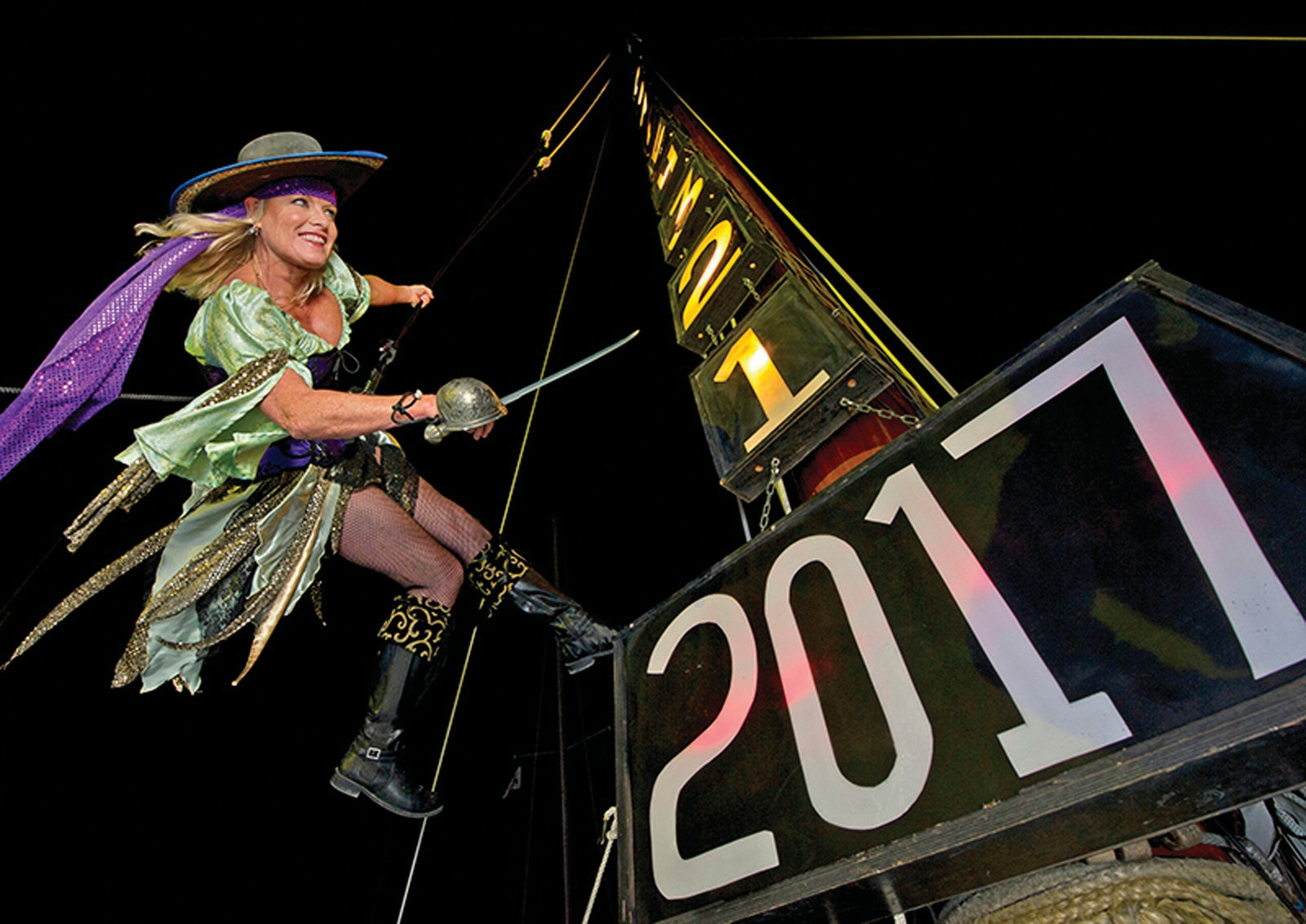Evalena Worthington, costumed as a pirate wench, practices being lowered from the mast of the sailing vessel America 2.0 outside the Schooner Wharf Bar late Friday, Dec. 30, 2016, in Key West. The Pirate Wench Drop, set for New Year's Eve, is one of four distinct drops Key West offers to answer New York City's Times Square ball drop to mark the beginning of the New Year. ROB O'NEAL / FLORIDA KEYS NEWS BUREAU/HO