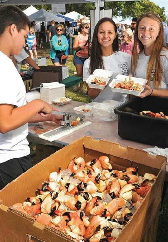 Festival participants sample fresh caught seafood. COURTESY PHOTO