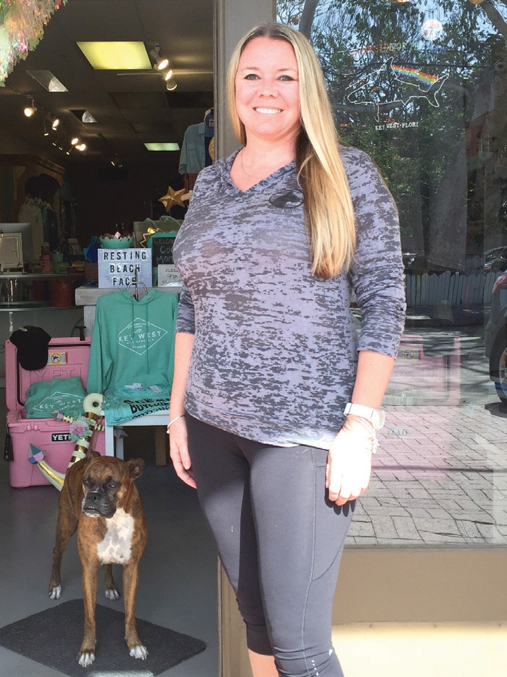 Courtney Collins with her rescue dog Molly by her side. JENNIFER WHITE/ FLORIDA WEEKLY