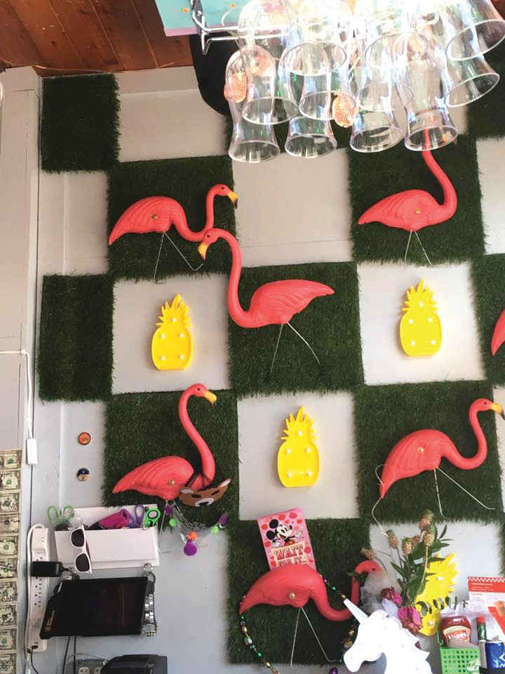 The decor at 22&Co. consists of grass, pineapples and flamingos. Tutus hug stools ready for a fun evening.