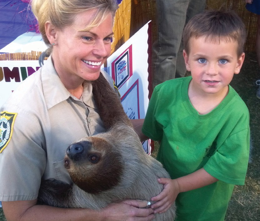 Jeanne Selander shows off a sloth at the animal farm. COURTESY PHOTO