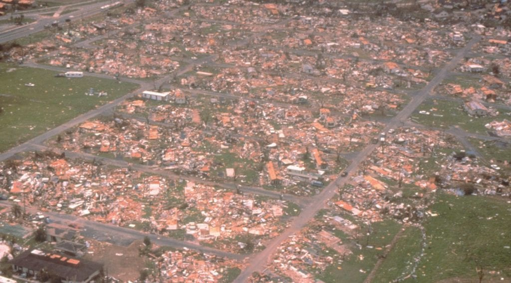 An aerial view of Miami-Dade County showing damage from one of the most destructive hurricanes in the history of the United States. Hurricane Andrew did extensive damage to homes in Miami, leaving little behind in its wake. One million people were evacuated and 54 died in this hurricane. BOB EPSTEIN, FEMA NEWS PHOTO