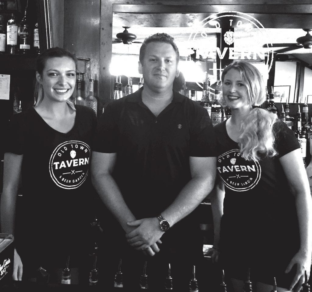 Nick Dent (middle ) with server Emily Greg, left, and bartender Jessica Bowman, right.