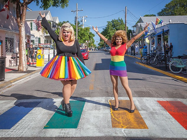 Inga, left, and Maya Montana, right, celebrate in the rainbow crosswalk on Duval Street.