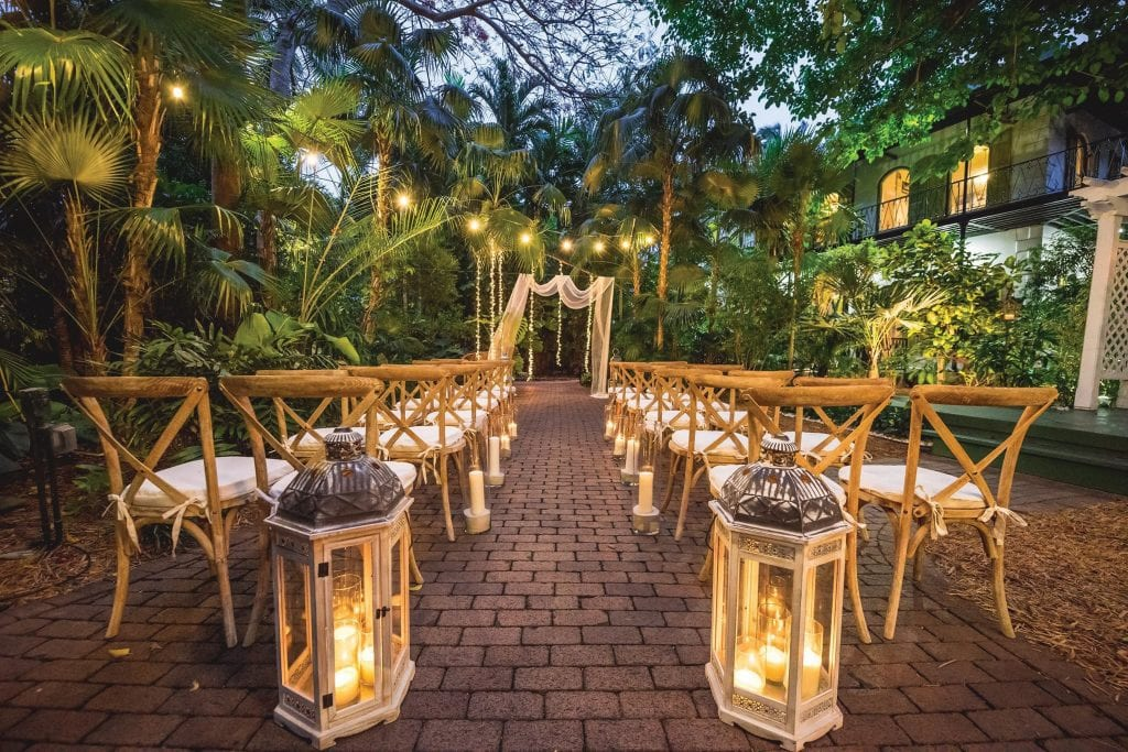 Two of Key West's most popular wedding venues offer lush foliage alongside a heavy dose of history: the Hemingway House, above, and the Audubon House & Tropical Gardens. HEMINGWAY HOUSE / COURTESY PHOTOS