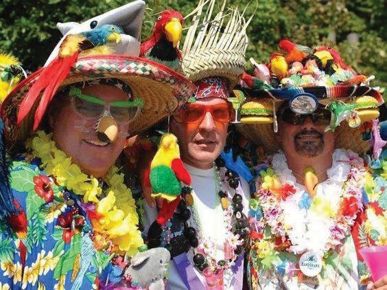 The Parrot Heads are renowned for their colorful costumes. COURTESY PHOTO