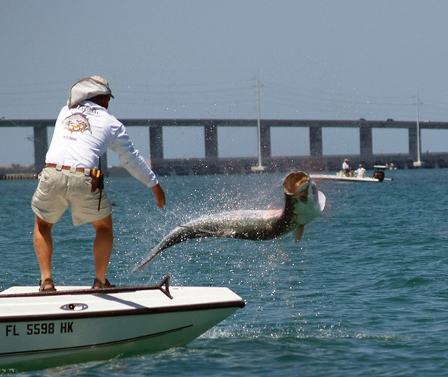 Bringing in a tarpon near the Bahia Honda Bridge. FISHING BOOKER / COURTESY PHOTO