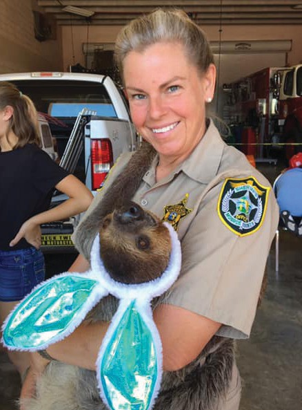 Jeanne Selander with local celebrity Mo the sloth at the Sheriff's Animal Farm. COURTESY PHOTO