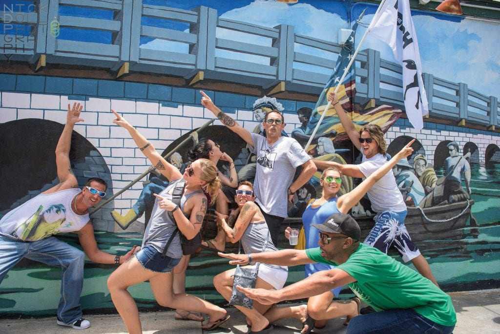 Spirited locals recreate the famous Rick Worth mural outside Bobby's Monkey Bar. COURTESY PHOTOS