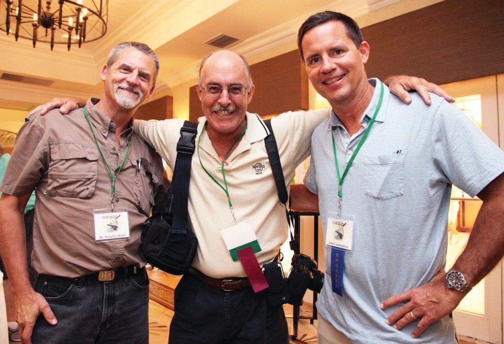 Author John Cunningham, right, with Florida Keys veterinarian Douglas Mader, left, and former Key West Citizen photographer Mike Hentz, at a previous Mystery Fest Key West. PHOTO BY CAROL TEDESCO
