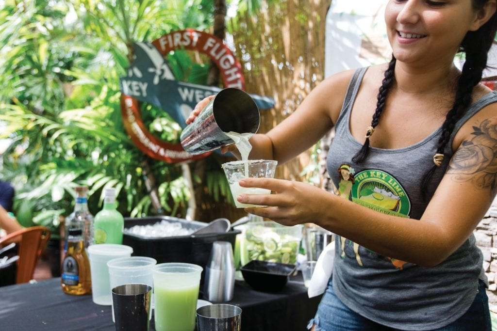 Deanna Kay Cox mixes up a Key lime cocktail at First Flight Restaurant during last year's Key Lime Cocktail Sip 'n Stroll. COURTESY PHOTO