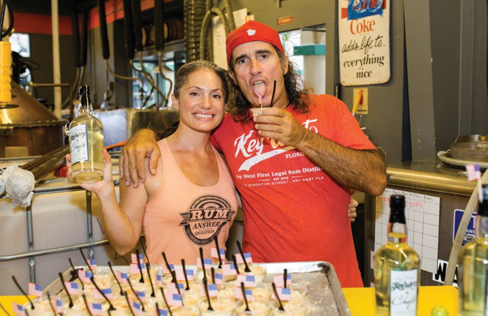 Crystal Villegas and Paul Menta show off their First Legal Rum Distillery Key lime cocktail.