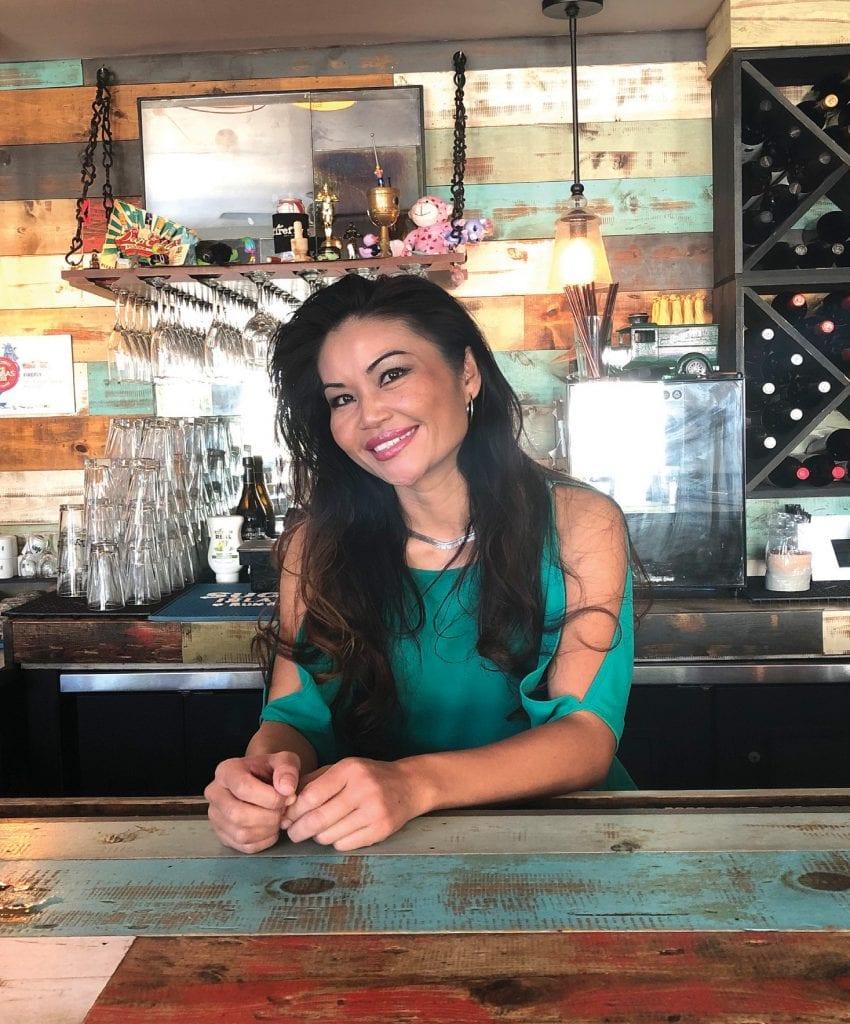 Kayla behind the bar at Firefly. COURTESY PHOTOS