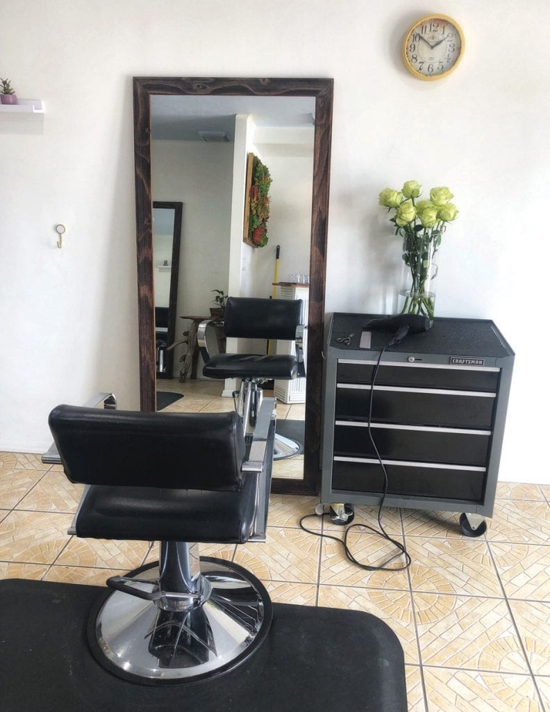 CocoPlum Island Salon, located on North Roosevelt Boulevard, is intimate and cozy. Walls and shelves are decorated with artwork created by the owner, Courtney Howard.