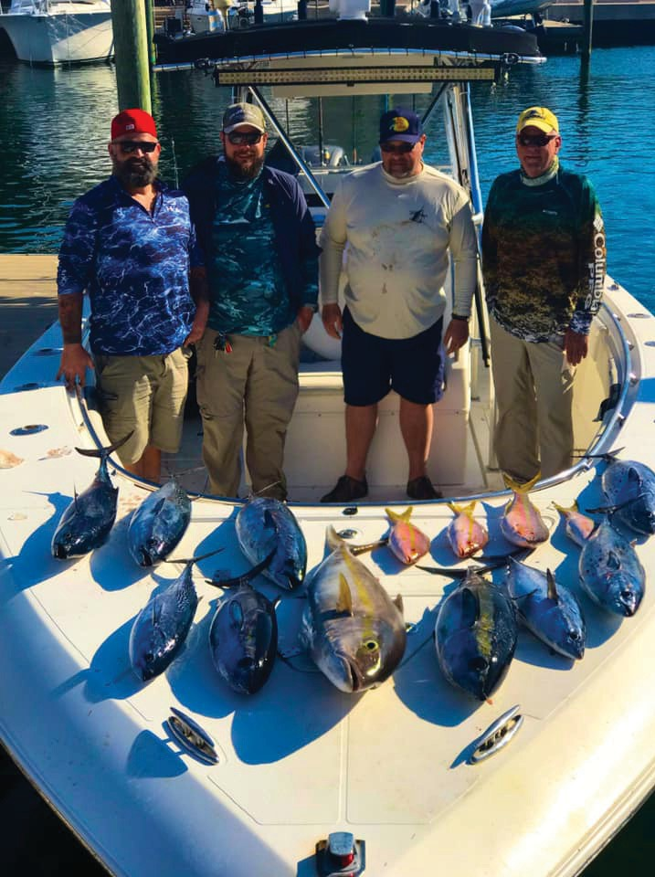 Four happy fishermen with the spoils of a hard day's play on Keys Customs Charters. COURTESY PHOTOS