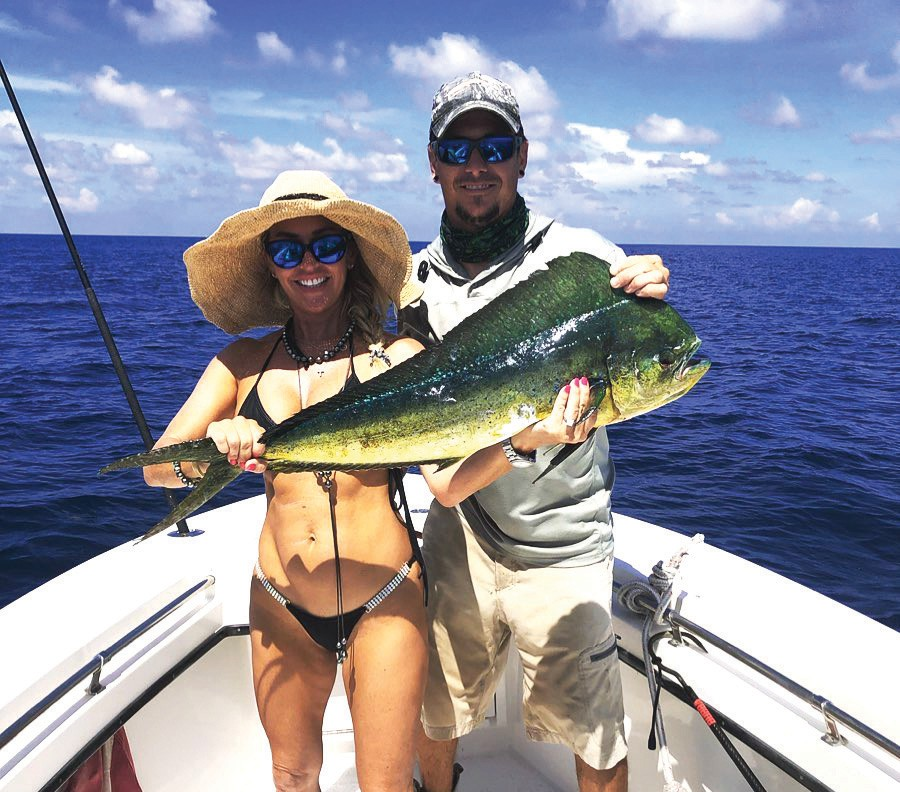 Far Out Charters: Great day offshore with Casey and Brandy. Started off with a quadrupole header, landing all four, this mahi being one. — Far Out Charters Harbor Yacht Club, 6000 Peninsular Ave., Key West 305-747-4632 https://www.faroutcharters.com