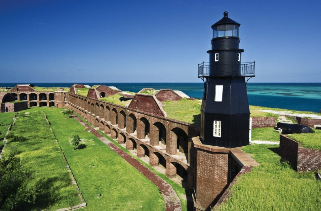 The walls of Fort Jefferson are situated on tropical Garden Key, presently a part of Dry Tortugas National Park.
