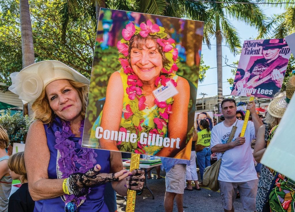 Caroline Cotton holds up a placard of the late, great arts champion Connie Gilbert during a previous Crooks Annual Second Line celebration. RALPH DEPALMA / COURTESY PHOTOS