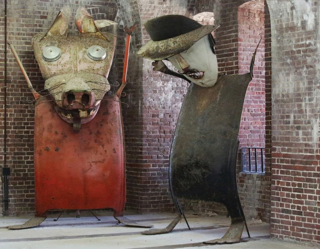 """Today, The Rabbit"""" (left) and """"The Preacher"""" (right) are among 100 Stanley Papio sculpture collection pieces stewarded by the Society and on exhibit at Fort East Martello Museum. A kinetic parade to honor the artist was the brainchild of former Society staff member Gerri Sidoti."""