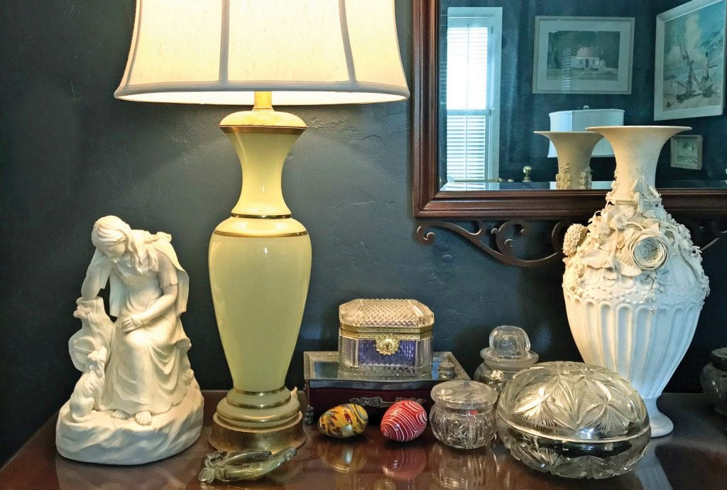 I covered my dresser with things I enjoy waking up to — Parian figure and vase, a green opaline lamp and Murano glass eggs. SCOTT SIMMONS / FLORIDA WEEKLY