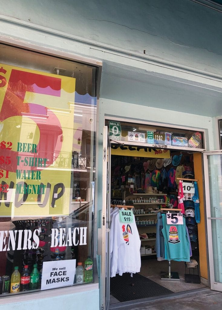 """A Duval Street novelty shop advertises """"We sell FACE MASKS."""""""