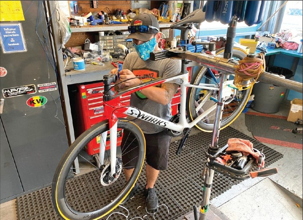 An employee tunes up a bicycle at Island Bicycles in Key West. COURTESY OF ISLAND BICYCLES