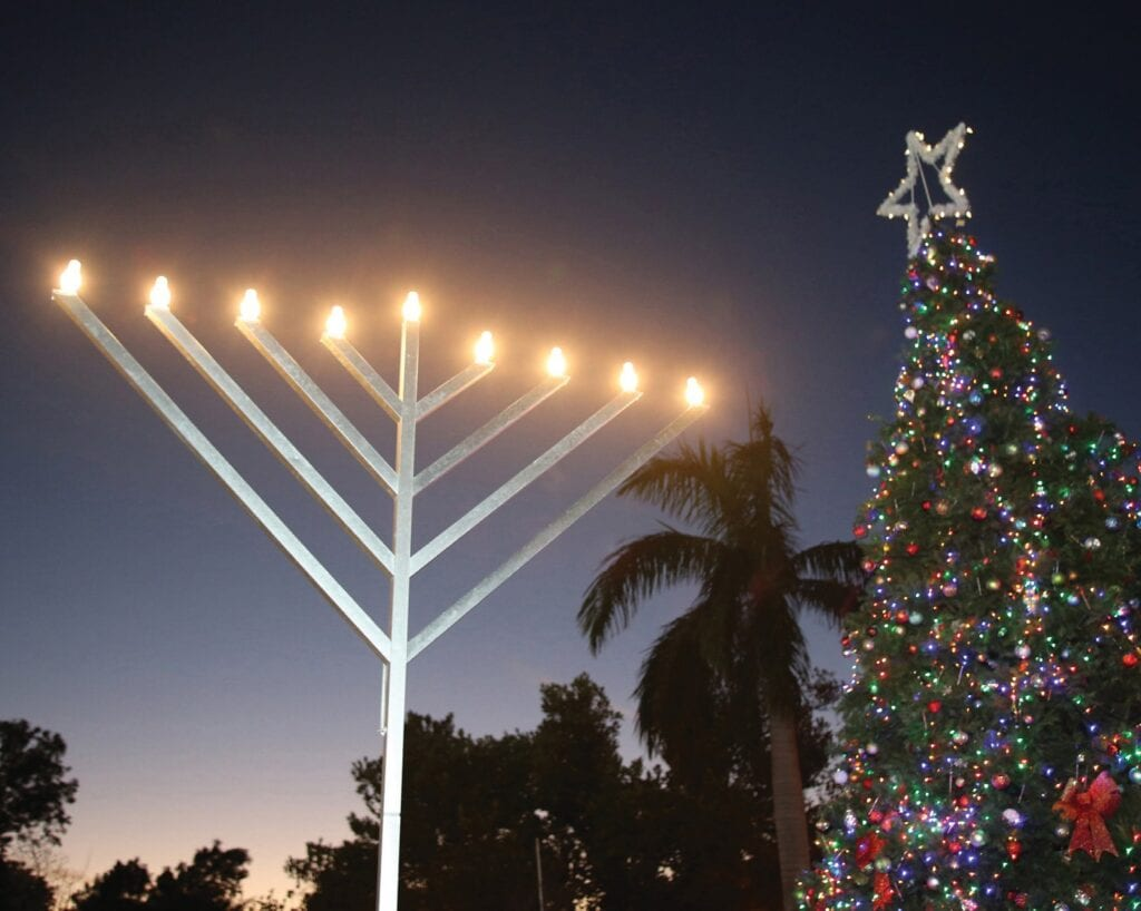 A Menorah and a Christmas tree illuminate Bayview Park in Key West on Thursday, Dec. 10, the first night of Hanukkah COURTESY PHOTO