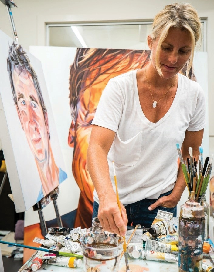 LEFT: Letty Nowak at work on the large-scale portraits she paints.